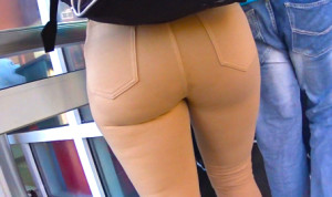 Latina in tan pants